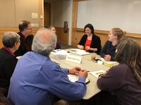 Trust Manager Aili Schreiner (second from right) meets with grant seekers at a pre-COVID Conversations event.