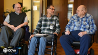 Veteran volunteer Emil Graziani (center) talks with two veterans about benefits they may qualify for at the Oregon Veterans' Home in Lebanon.