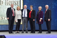 Former OFB President Barry Bushue (center) is joined on stage at the AFBF Convention by (from left) AFBF Vice President Scott VanderWal, Helen Bushue, OFB President Barb Iverson, former OFB President Sharon Waterman, and Kentucky Farm Bureau President Mar