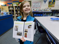 South Ridge Elementary School first grader, Teegan Thompson, proudly shares her Flat Stanley pages.