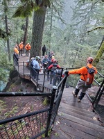 Rescue crews work to assist man who crossed the safety railing at Toketee Falls on Sunday afternoon.