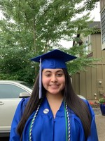 Graduating high school senior Lyssa Ibarra, Blanchet Catholic School, wears her Service Honors pin for her service over multiple years with One Thousand Soles.