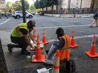 Taking samples at storm drain in front of federal courthouse July 31