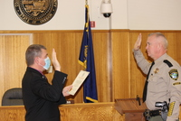 Sheriff Hanlin takes his oath of office administered by County Clerk Dan Loomis
